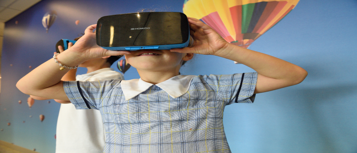Child and VR Headset